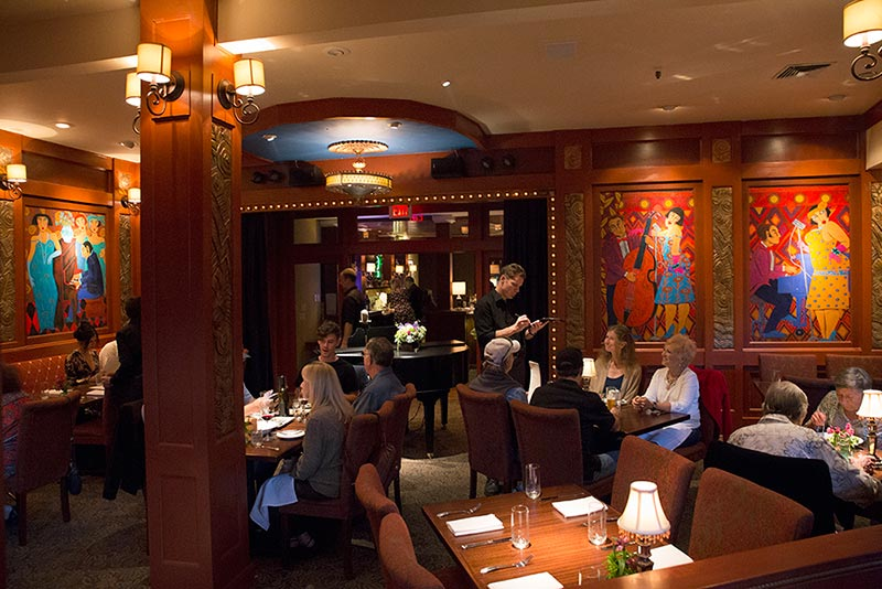 Hearsay dining room features bold paintings, comfortable seating, excellent service and food